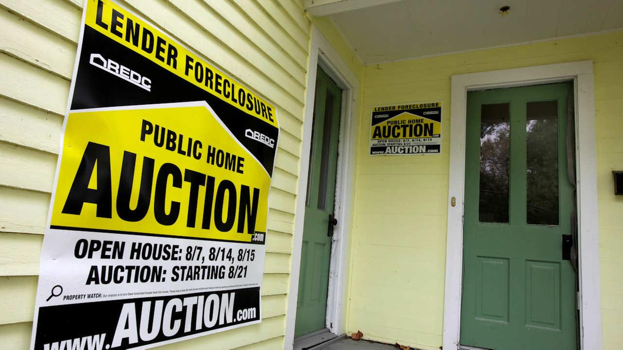 In this Sept. 22, 2010 photograph, a home has a foreclosure auction sign displayed.