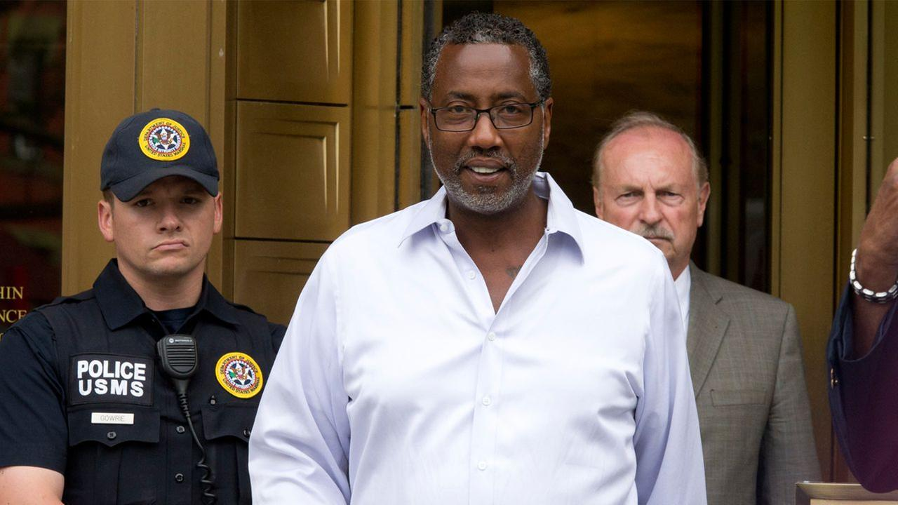Norman Seabrook, center, president of the New York City Correction Officers Benevolent Association, leaves court, Wednesday June 8, 2016, in New York.