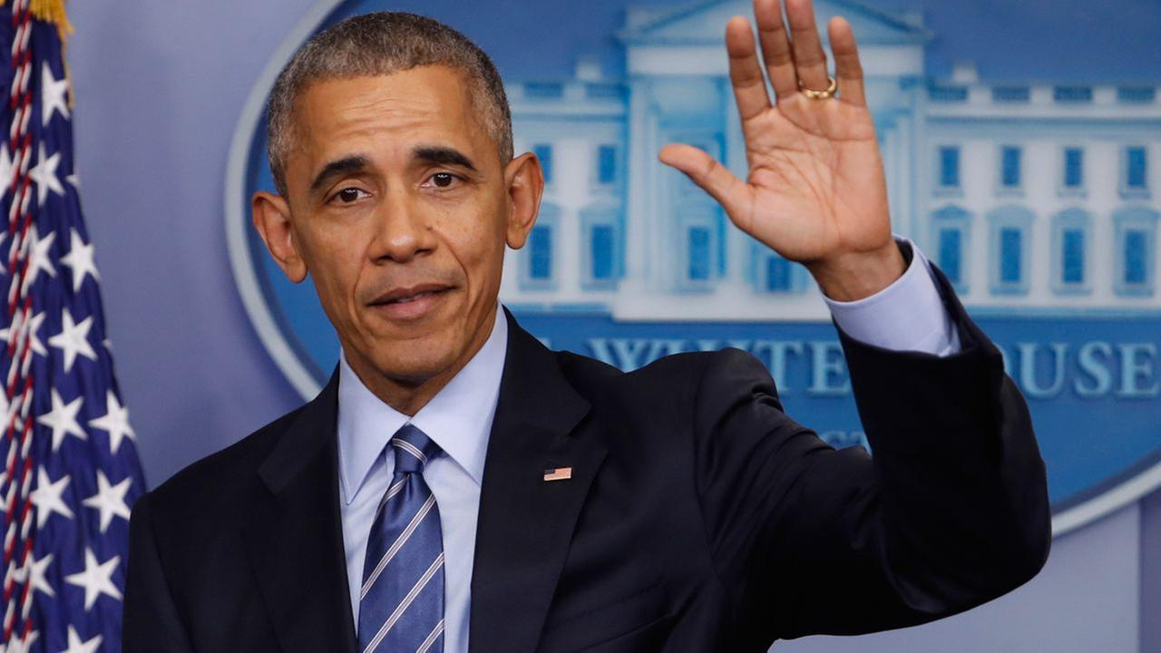 President Barack Obama waves at the conclusion of his news conference in the briefing room of the White House in Washington, Friday, Dec. 16, 2016.