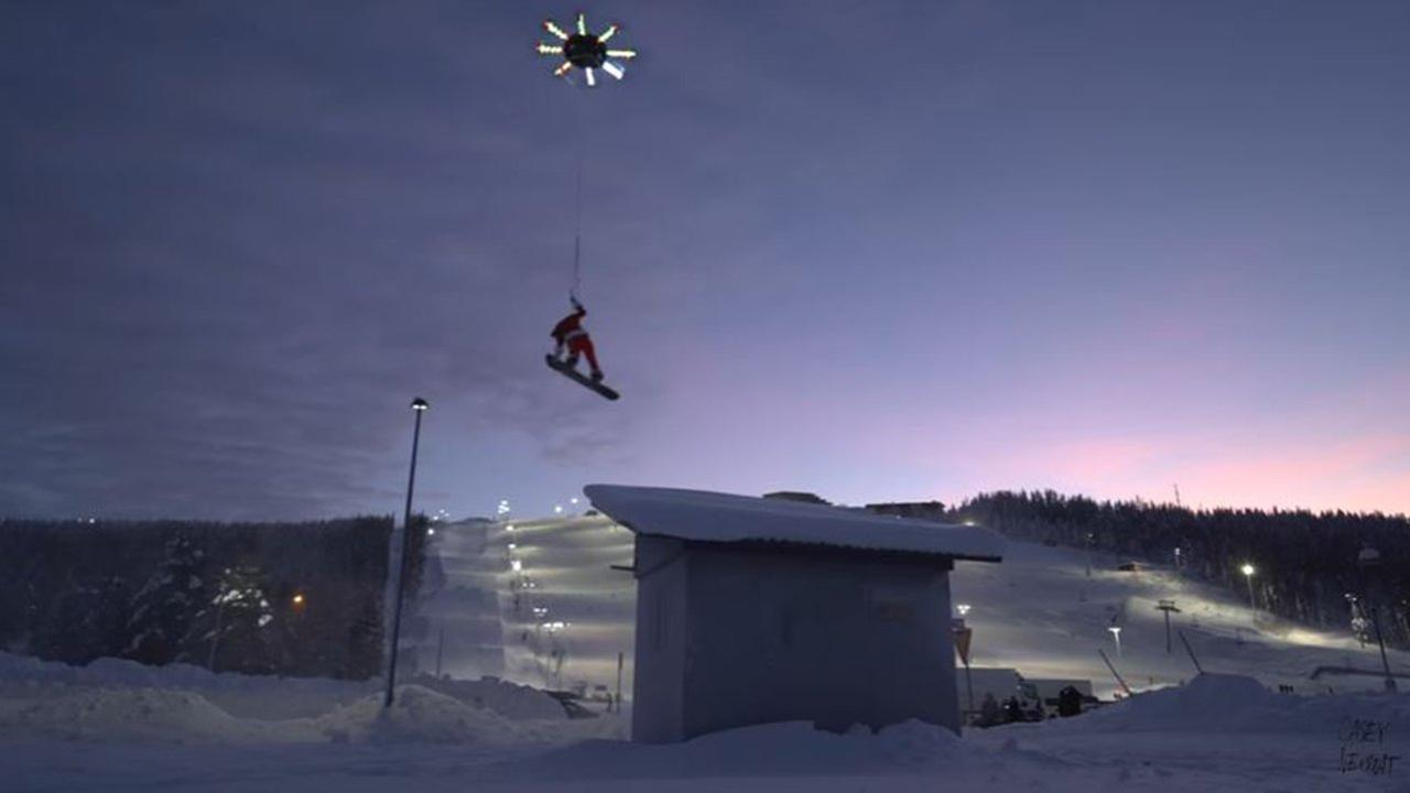 Watch a Supersized Drone Lift a Snowboarder Off a Mountain