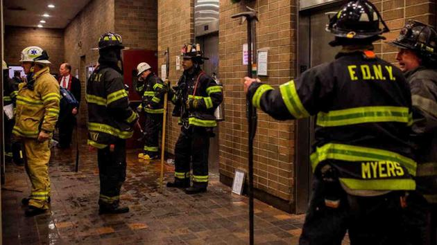 <div class='meta'><div class='origin-logo' data-origin='AP'></div><span class='caption-text' data-credit='Andres Kudacki'>Firefighters gather in the lounge of the building as the fire is under control during a fire on the west side of Manhattan in New York, Thursday.</span></div>