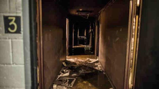 <div class='meta'><div class='origin-logo' data-origin='AP'></div><span class='caption-text' data-credit='Andres Kudacki'>A burnt hallway of the third floor of a building is seen empty after firefighters have extinguished a fire on the west side of Manhattan in New York, Thursday.</span></div>