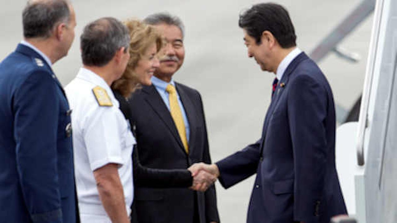 Caroline Kennedy, U.S. Ambassador to Japan, third from left, greets Japans Prime Minister Shinzo Abe at Joint Base Pearl Harbor Hickam, Monday, Dec. 26,