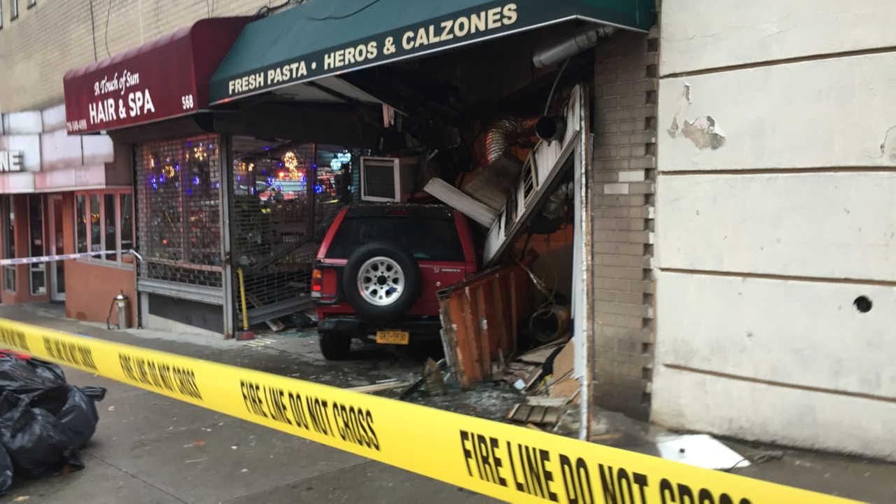 2 injured after car slams into Bronx pizzeria