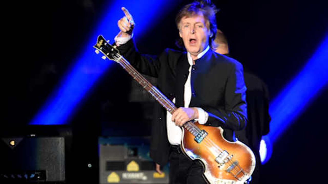 Paul McCartney greets the crowd as he arrives onstage for his performance at the 2016 Desert Trip music festival in Indio, Calif.  (Photo by Chris Pizzello/Invision/AP)