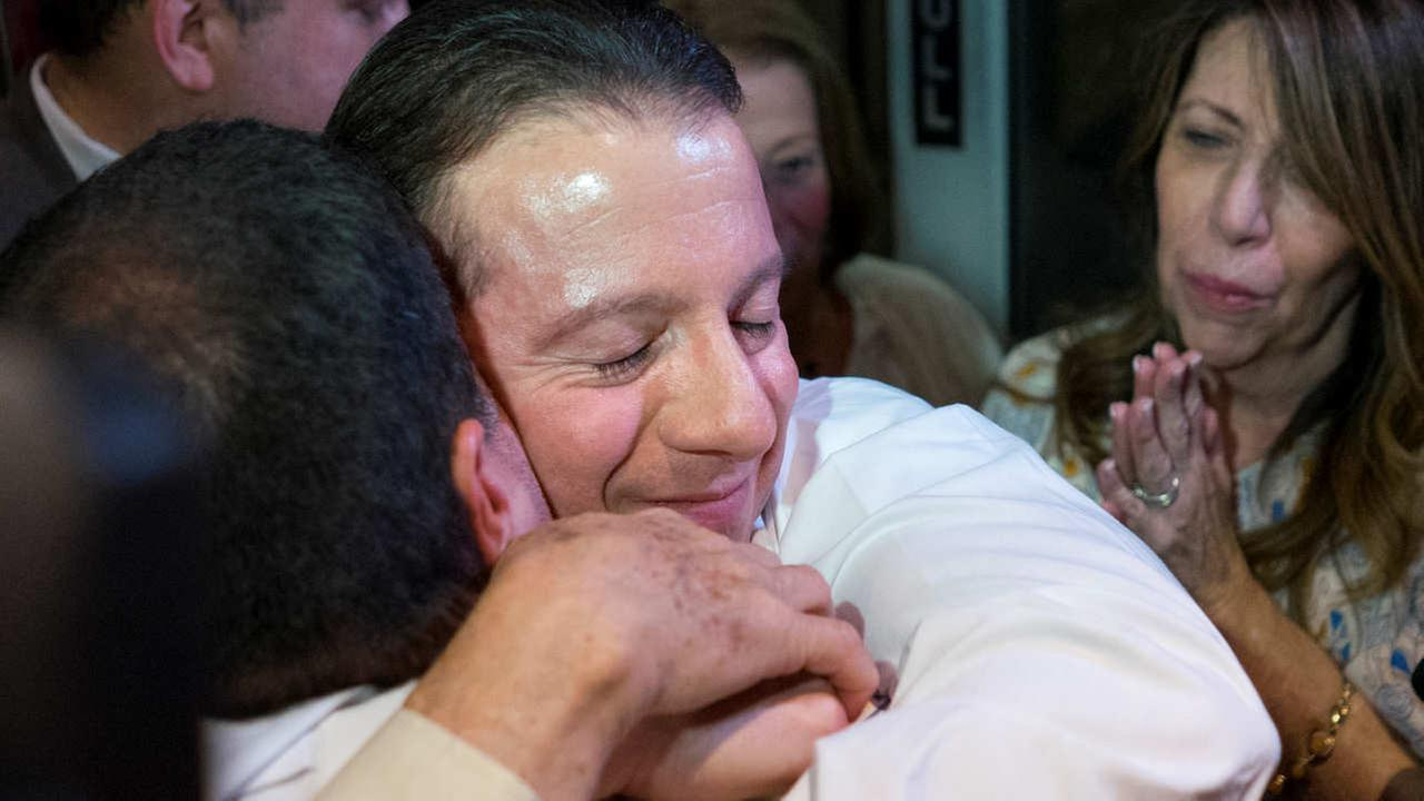 Johnny Hincapie, center, hugs a family member as he leaves a court building Tuesday, Oct. 6, 2015, in New York.