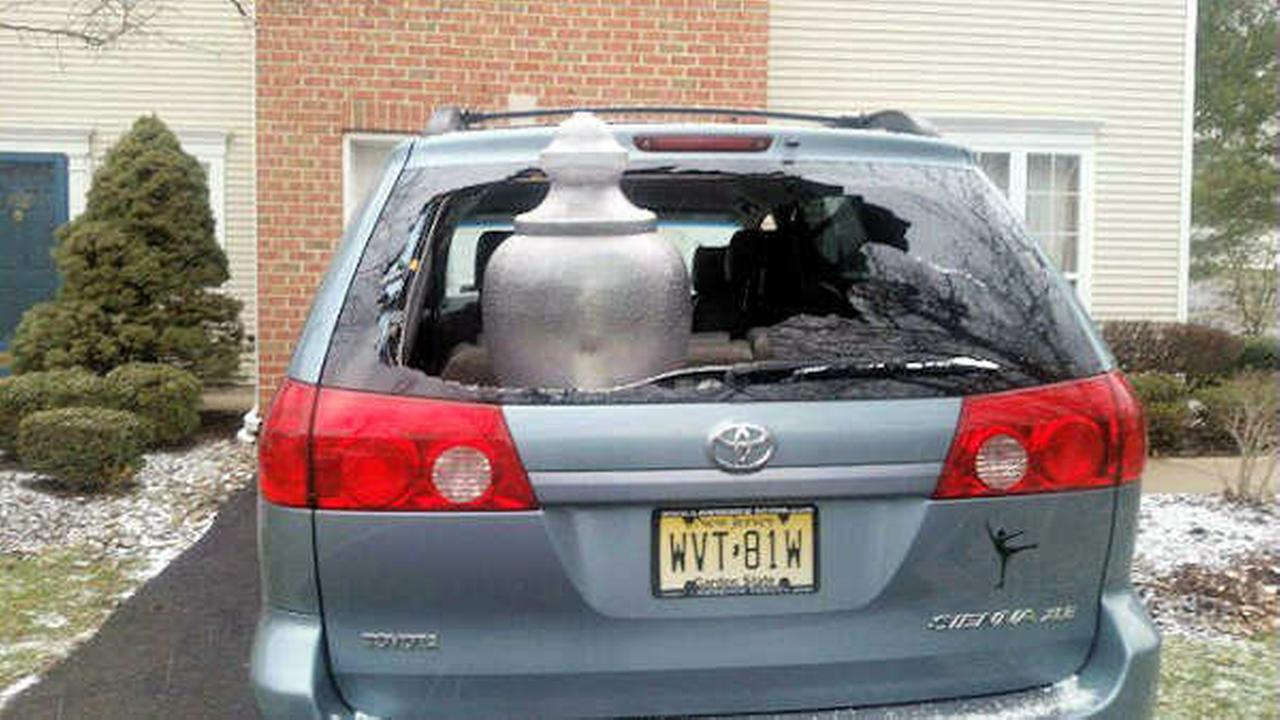 New Jersey driver backs into street lamp that lands in back seat of car