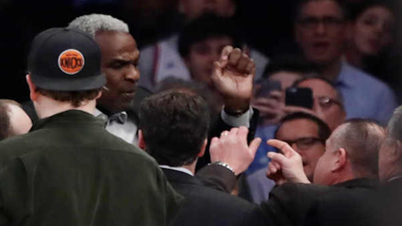 Charles Oakley exchanges words with a security guard during the first half of an NBA basketball game between the New York Knicks and the LA Clippers