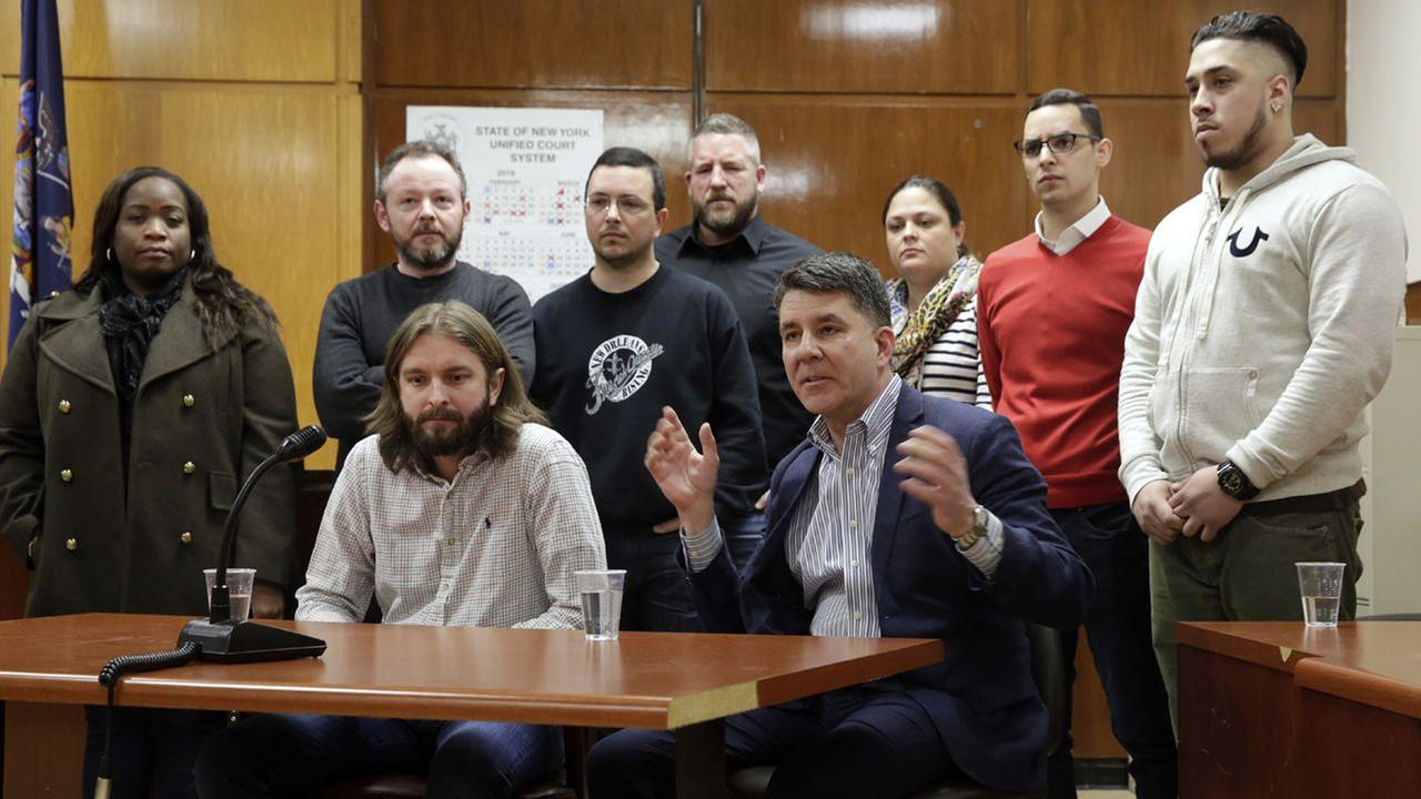 Tom Hoscheid, and Michael Castellon, foreground left and right, are joined by fellow jurors in the Pedro Hernandez case during a news conference Tuesday, Feb. 14, 2017, in New York