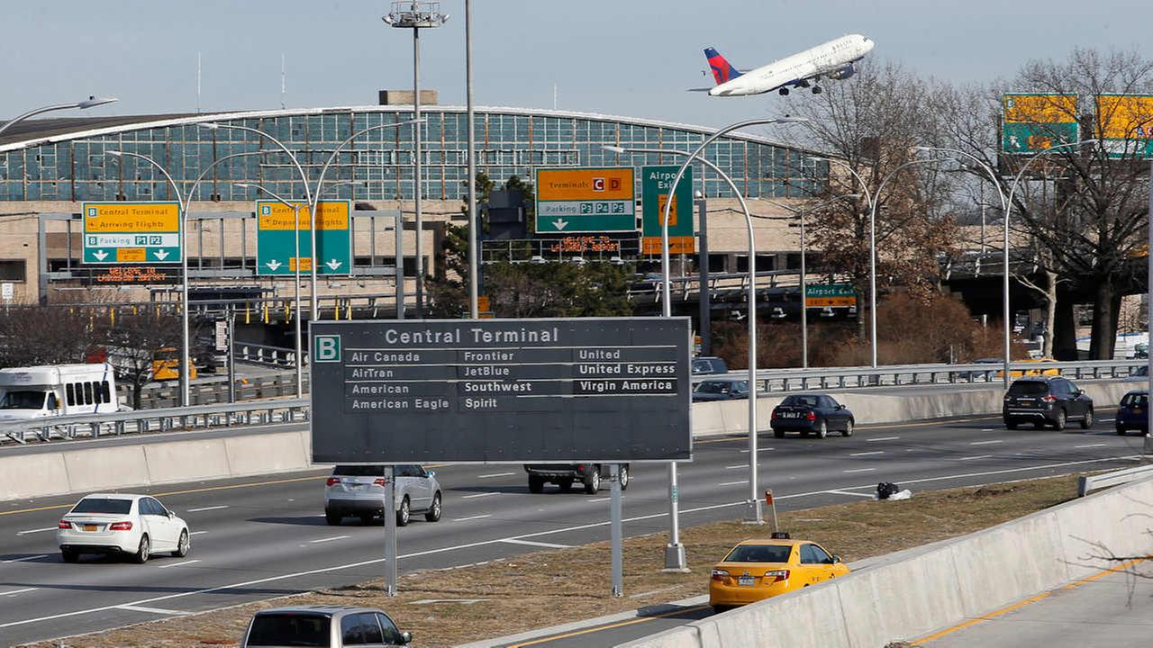 Cars on the Grand Central Parkway pass LaGuardia Airport in New York (AP Photo/Kathy Willens)