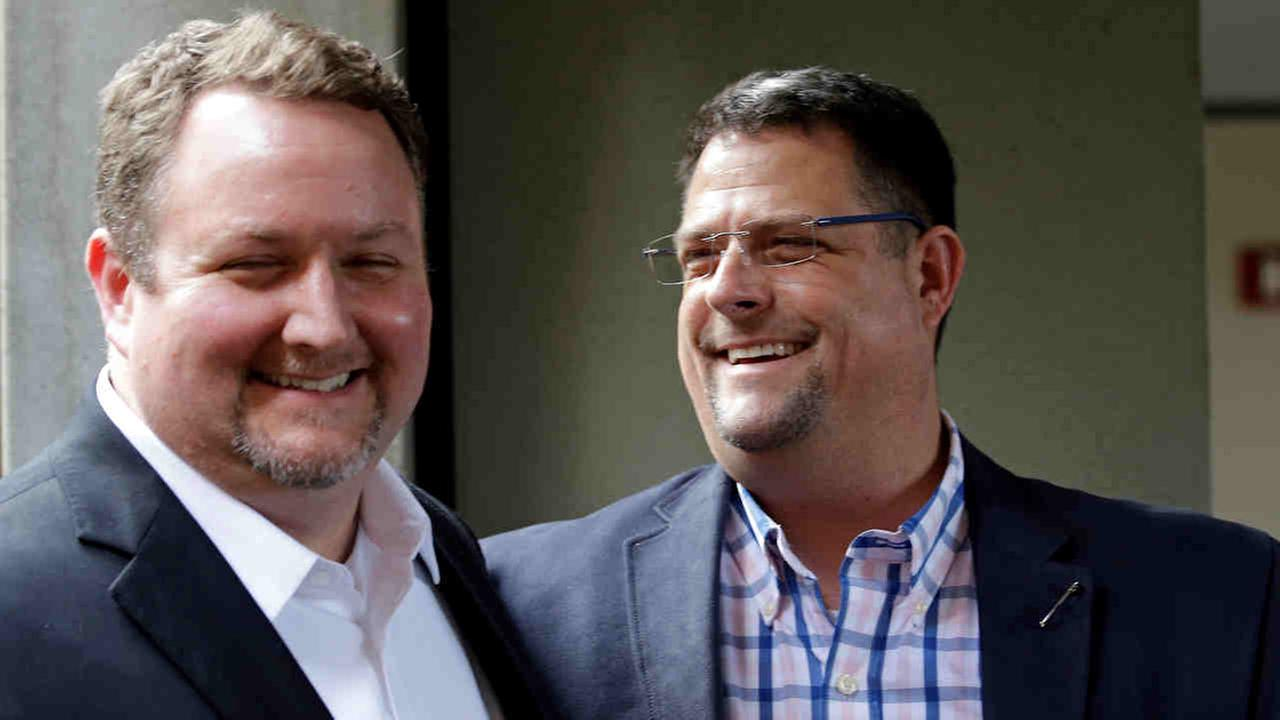 Curt Freed, left, and his husband Robert Ingersoll smile after a hearing before Washingtons Supreme Court, last year in Bellevue, Wash.