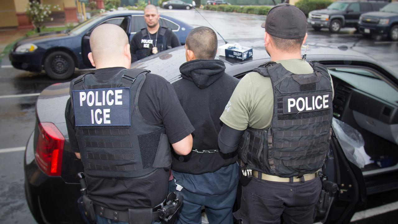 In this Tuesday, Feb. 7, 2017, photo released by U.S. Immigration and Customs Enforcement shows foreign nationals being arrested during a targeted enforcement operation.