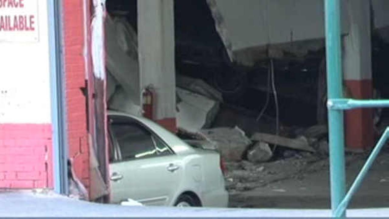 Cars crushed after parking garage collapses in the Bronx