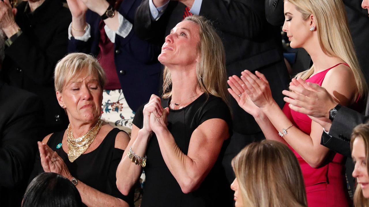 Carryn Owens, widow of widow of Chief Special Warfare Operator William Ryan Owens, is applauded on Capitol Hill in Washington, Tuesday, Feb. 28, 2017.