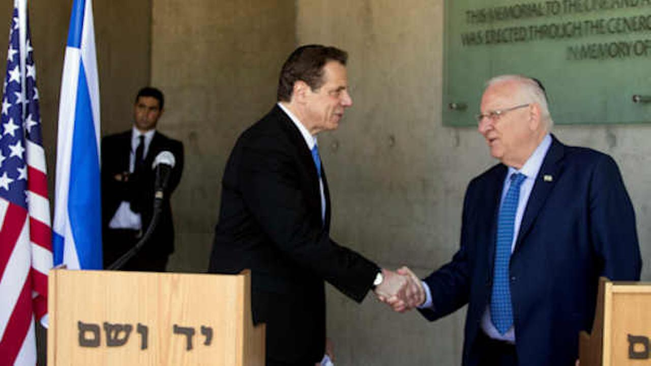 Andrew M. Cuomo, left, and Israeli President Reuven Rivlin shake hands at the Yad Vashem Holocaust memorial, in Jerusalem, Sunday, March 5, 2017. (AP Photo/Dan Balilty)