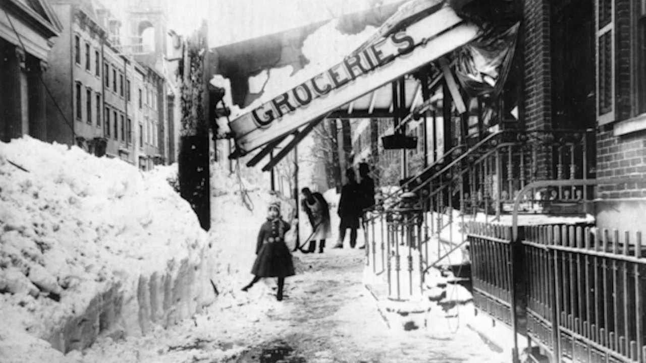 The awning of a grocery store is damaged from the weight of the snow during the blizzard of 1888 in New York City.   (AP Photo)