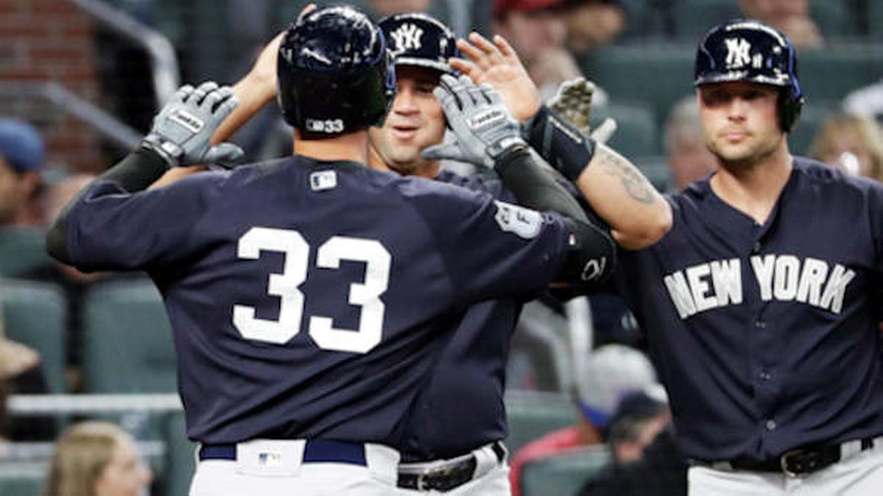 New York Yankees Greg Bird (33) is high-fived by teammate Gary Sanchez after they scored off Birds two-run home run in the third inning of an exhibition game.  (AP Photo)