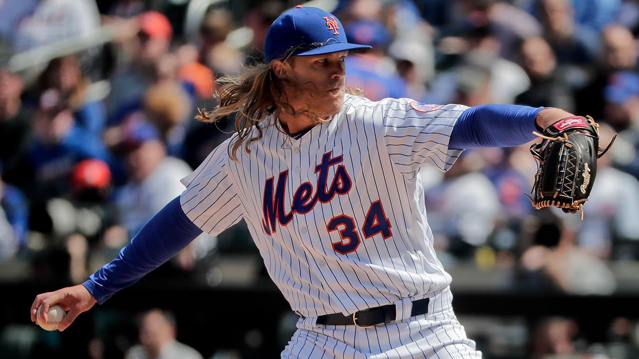 New York Mets pitcher Noah Syndergaard (34) delivers against the Atlanta Braves during the first inning of a baseball game, Monday, April 3, 2017, in New York.