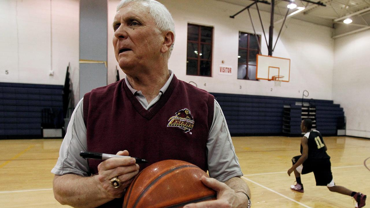 In this Wednesday, Feb. 2, 2011, file photo, Bob Hurley, head coach of the St. Anthony High School boys basketball team, signs a game ball in Jersey City, N.J.