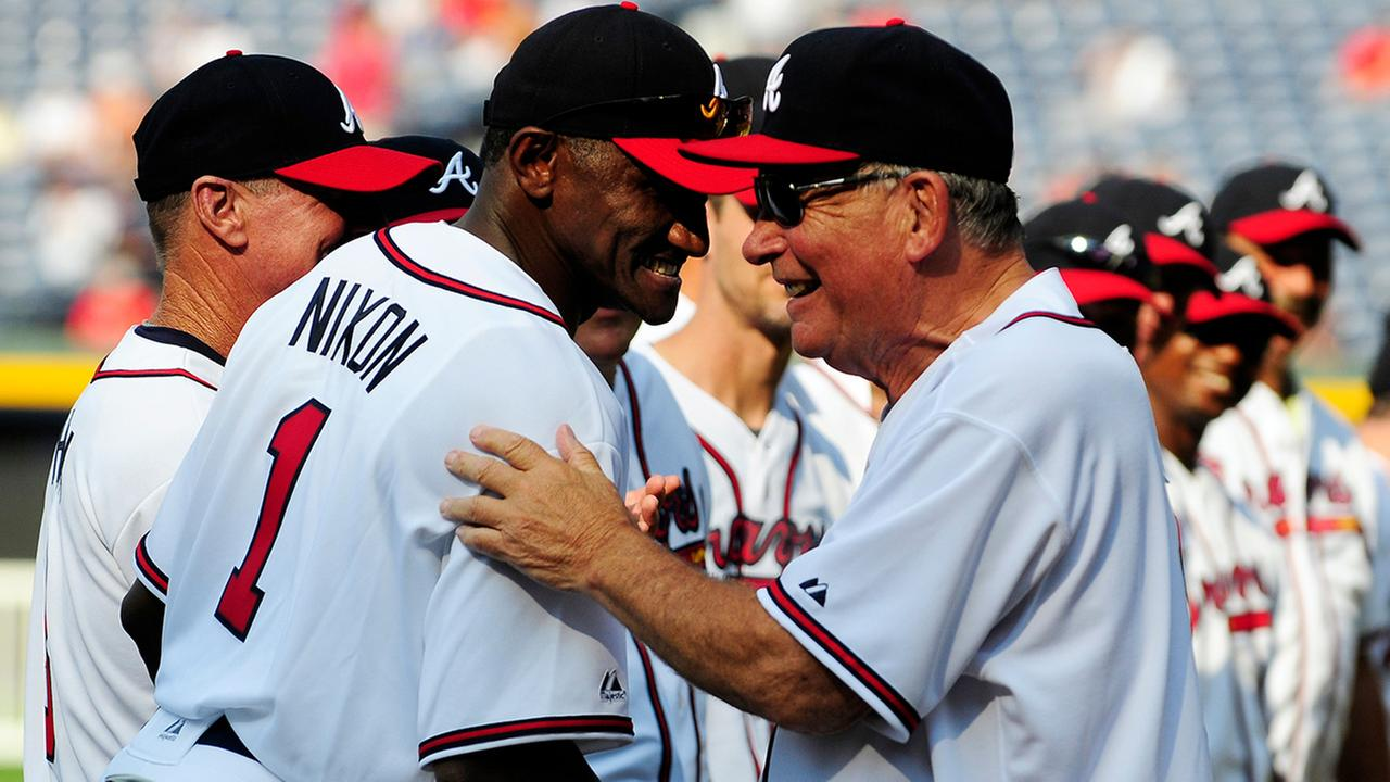 In this Aug. 13, 2011 file photo, former Atlanta Braves player Otis Nixon is greeted by former Braves manager Bobby Cox during a Braves Legends Game
