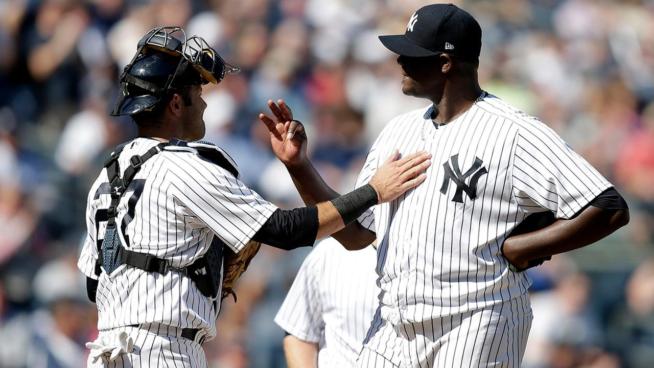 New York Yankees catcher Austin Romine talks with starting pitcher Michael Pineda in the eighth inning of the home opener against the Tampa Bay Rays