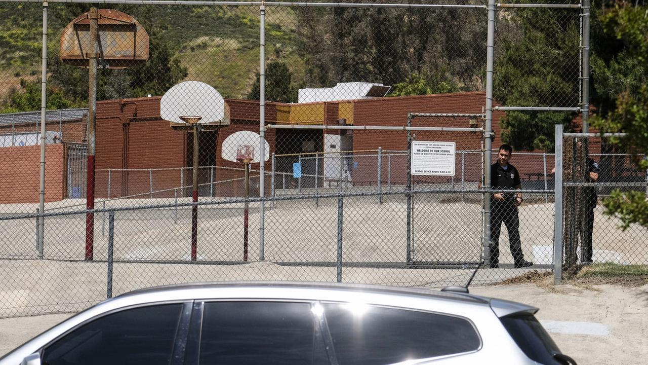 Police officers stand guard outside North Park School after a fatal shooting at the elementary school, Monday, April 10, 2017, in San Bernardino, California.AP Photo/Ringo H.W. Chiu
