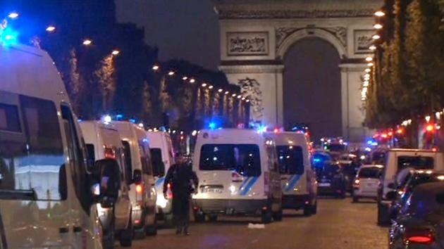 In this image made from video, police attend the scene after an incident on the Champs-Elysees in Paris, Thursday April 20, 2017.