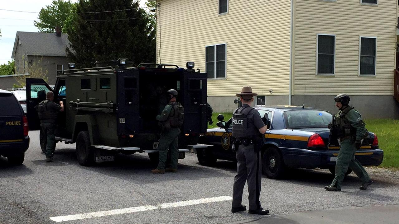 Police chief shot in upstate NY, suspect barricaded in home