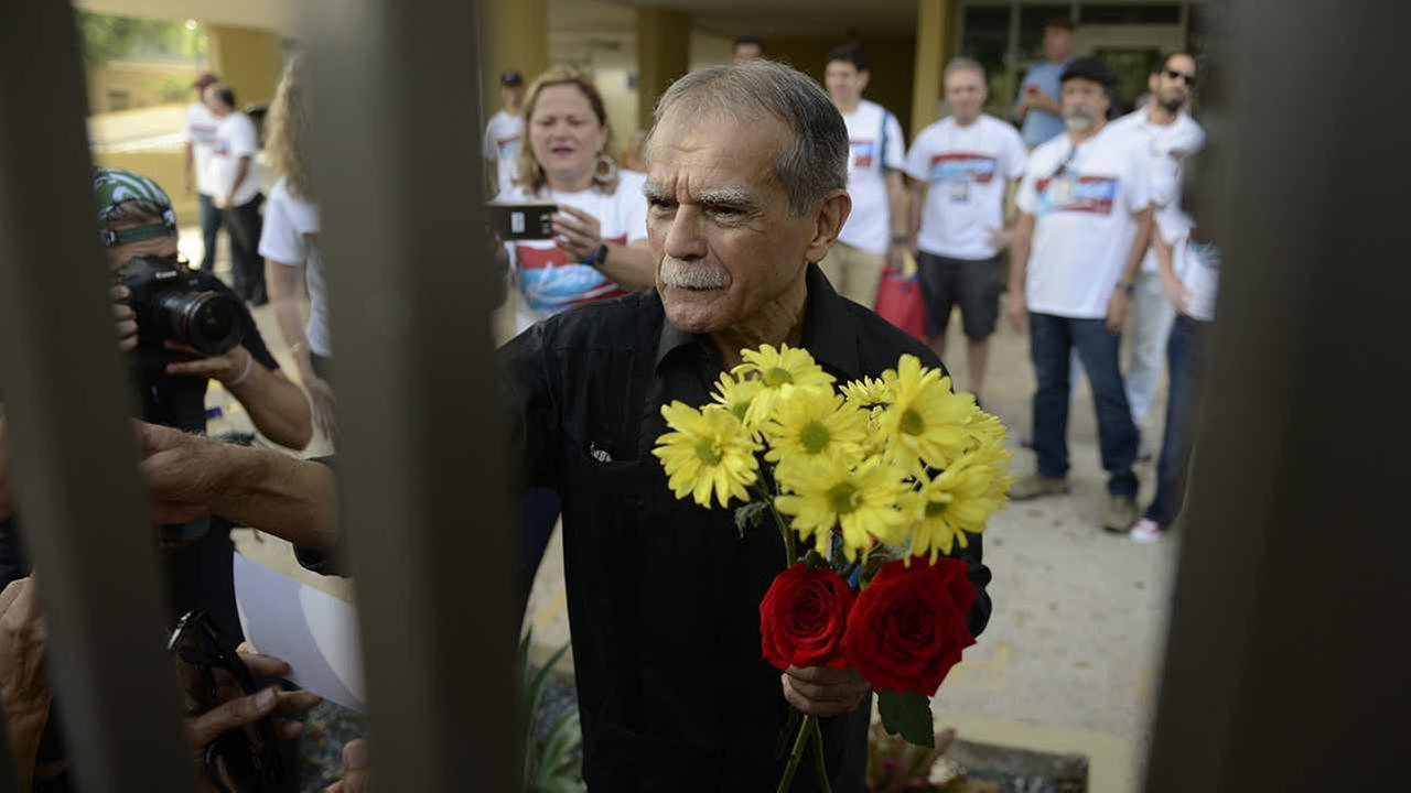 Puerto Rican nationalist Oscar Lopez Rivera greets well wishers as he is released from home confinement after 36 years in federal custody, in San Juan, Puerto Rico, Wednesday.