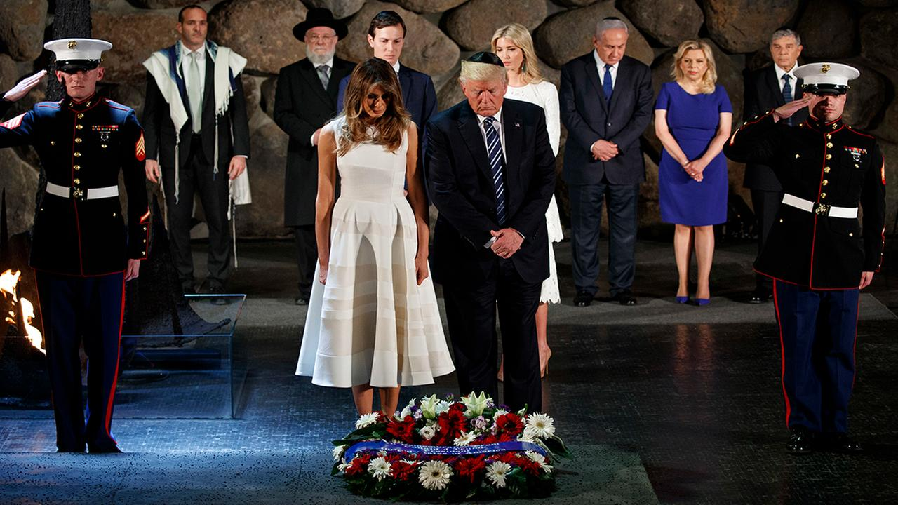 President Donald Trump and First Lady Melania Trump lay a wreath at Yad Vashem to honor the victims of the Holocaust, in Jerusalem, Tuesday, May 23, 2017. (AP Photo/Evan Vucci)