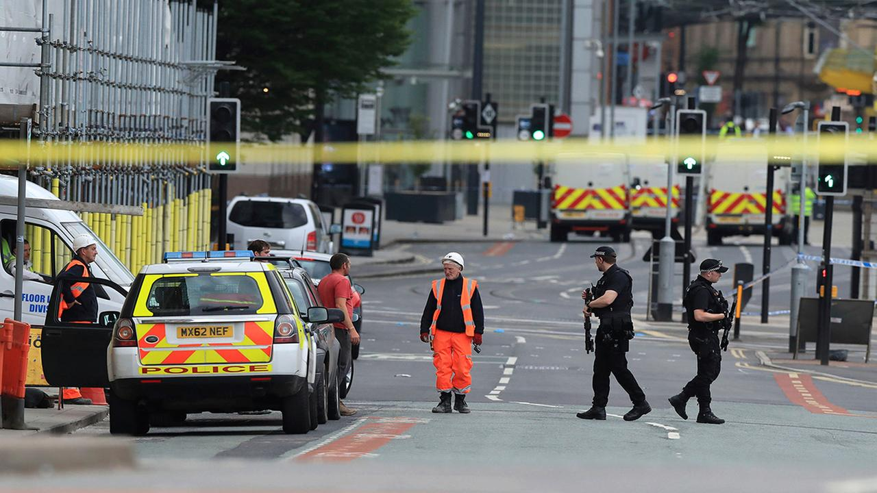 Police guard close to the Manchester Arena in Manchester, Britain, Tuesday May 23, 2017, a day after an explosion. (Peter Byrne/PA via AP)