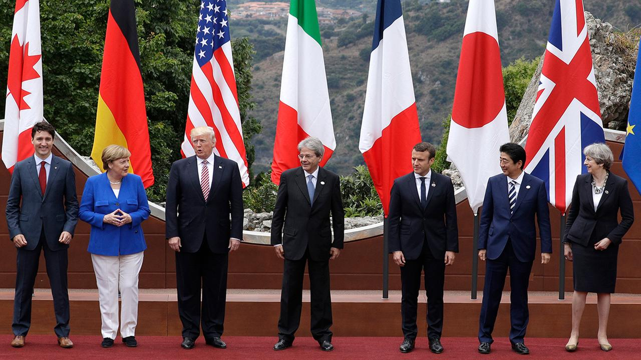 Leaders of the G7 pose during a group photo for the G7 summit in the Sicilian citadel of Taormina, Italy.  (AP Photo/Andrew Medichini)