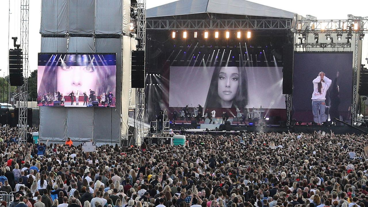 In handout photo provided by Owen Humphreys for One Love Manchester, singer Ariana Grande performs at the One Love Manchester concert. (Owen Humphreys via AP)