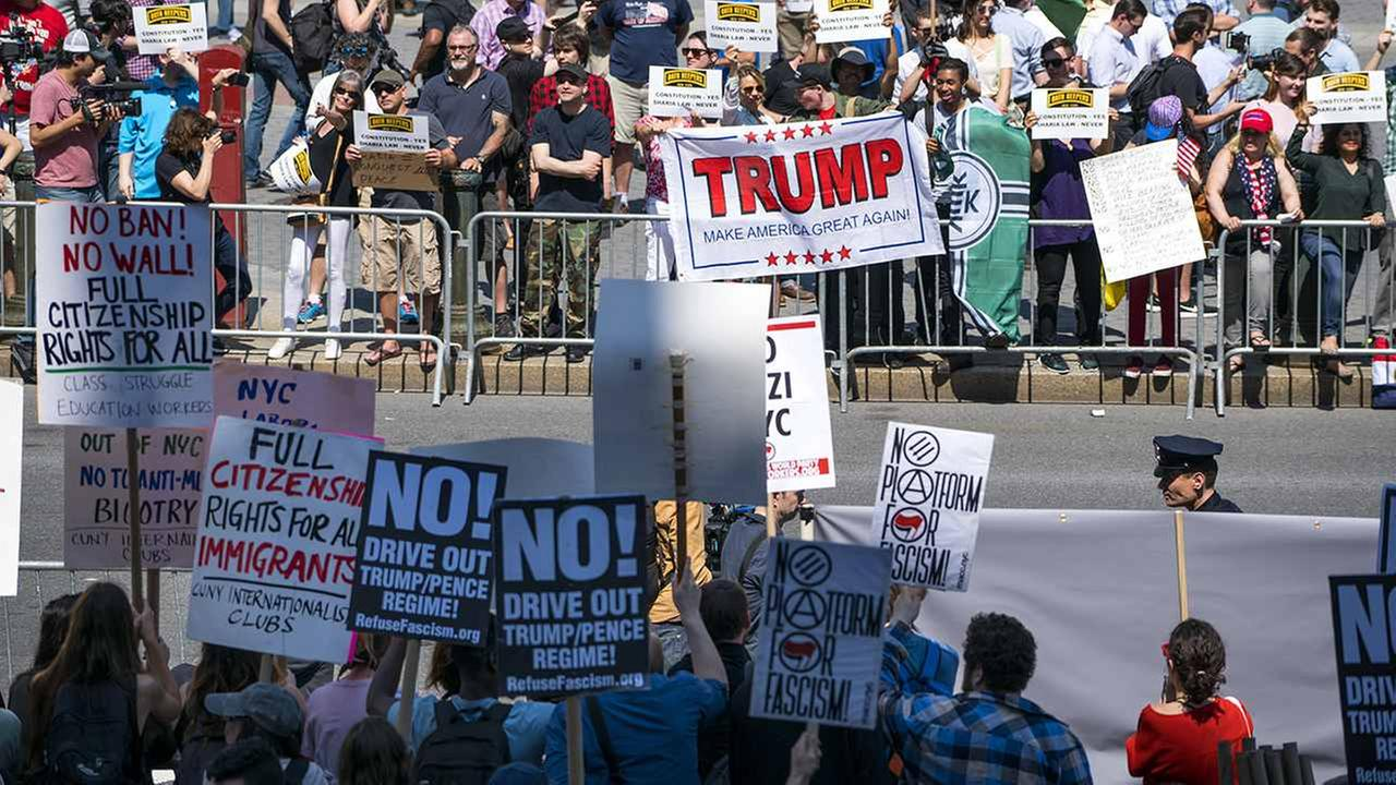 Demonstrators against Islamic law (background) gather in New York Saturday, as counter demonstrators line up across Centre Street.