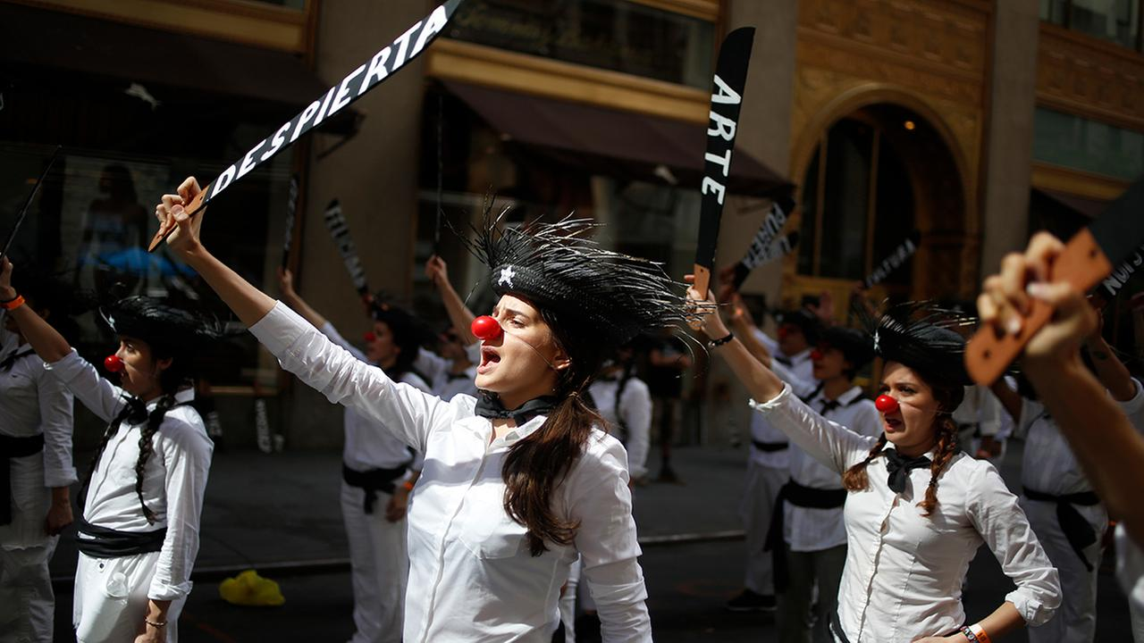 A group called Jibaros en Resistencia practice their routines before the start of the Puerto Rican Day Parade in New York, Sunday, June 11, 2017. (AP Photo/Seth Wenig)