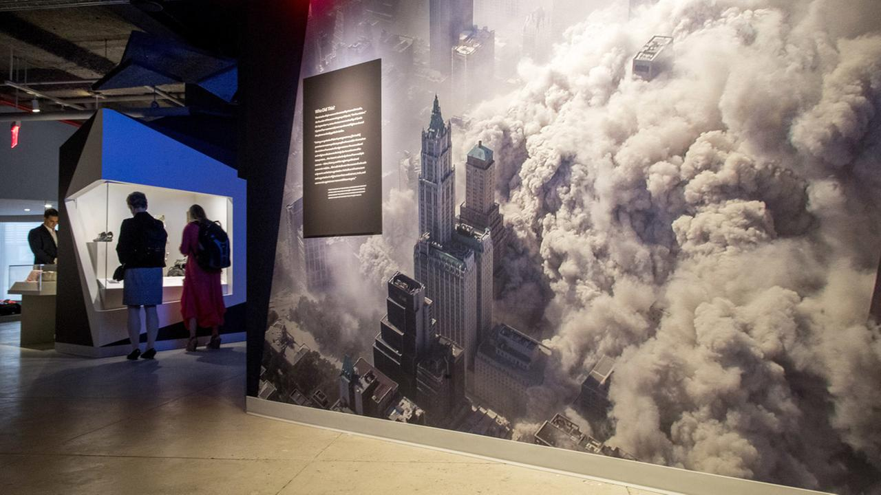 A giant photograph showing the cloud of debris that covered lower Manhattan after the collapse of one of the World Trade Center towers is on display at the 9/11 Tribute Museum.