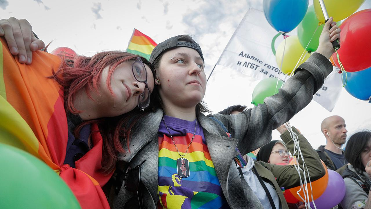 Gay rights activists gather to mark the International Day against homophobia, transphobia and biphobia in St. Petersburg, Russia, Wednesday, May 17, 2017.