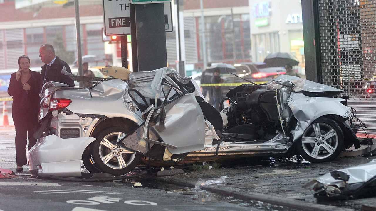 The driver of a sedan died when his car ran into a truck in Long Island City