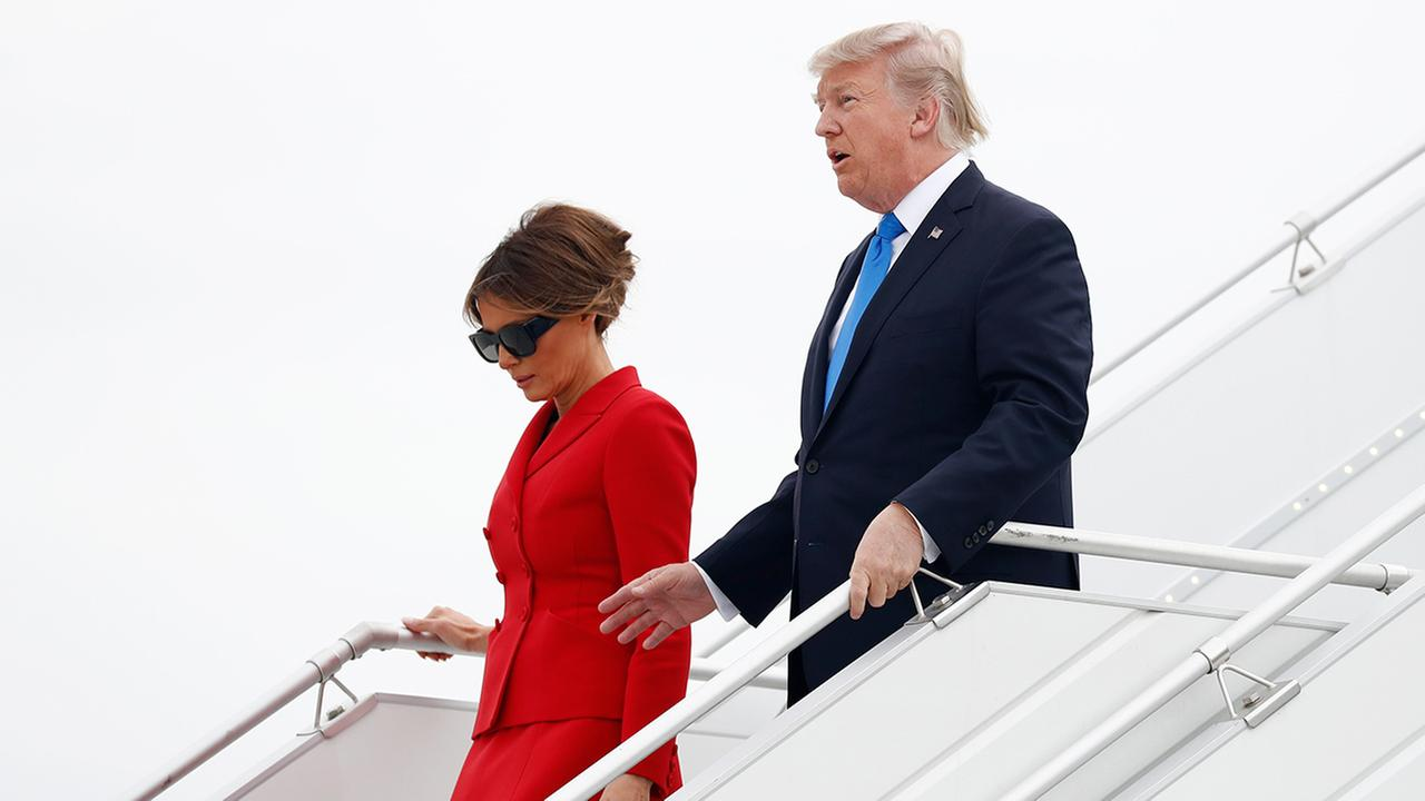 President Donald Trump and first lady Melania arrive on Air Force One at Orly Airport in Paris  (AP Photo/Carolyn Kaster)