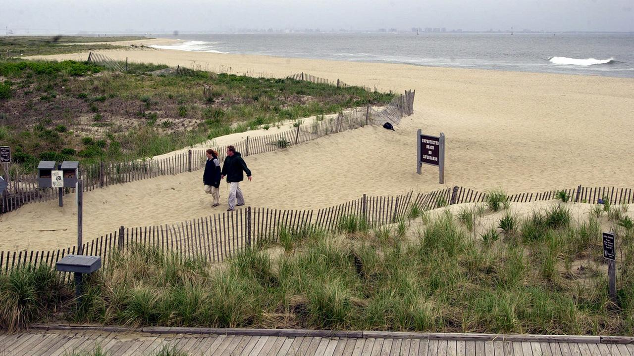 A couple walks on the beach at the Gateway National Recreation Area at Sandy Hook, New Jerse, Friday, May 18, 2001.
