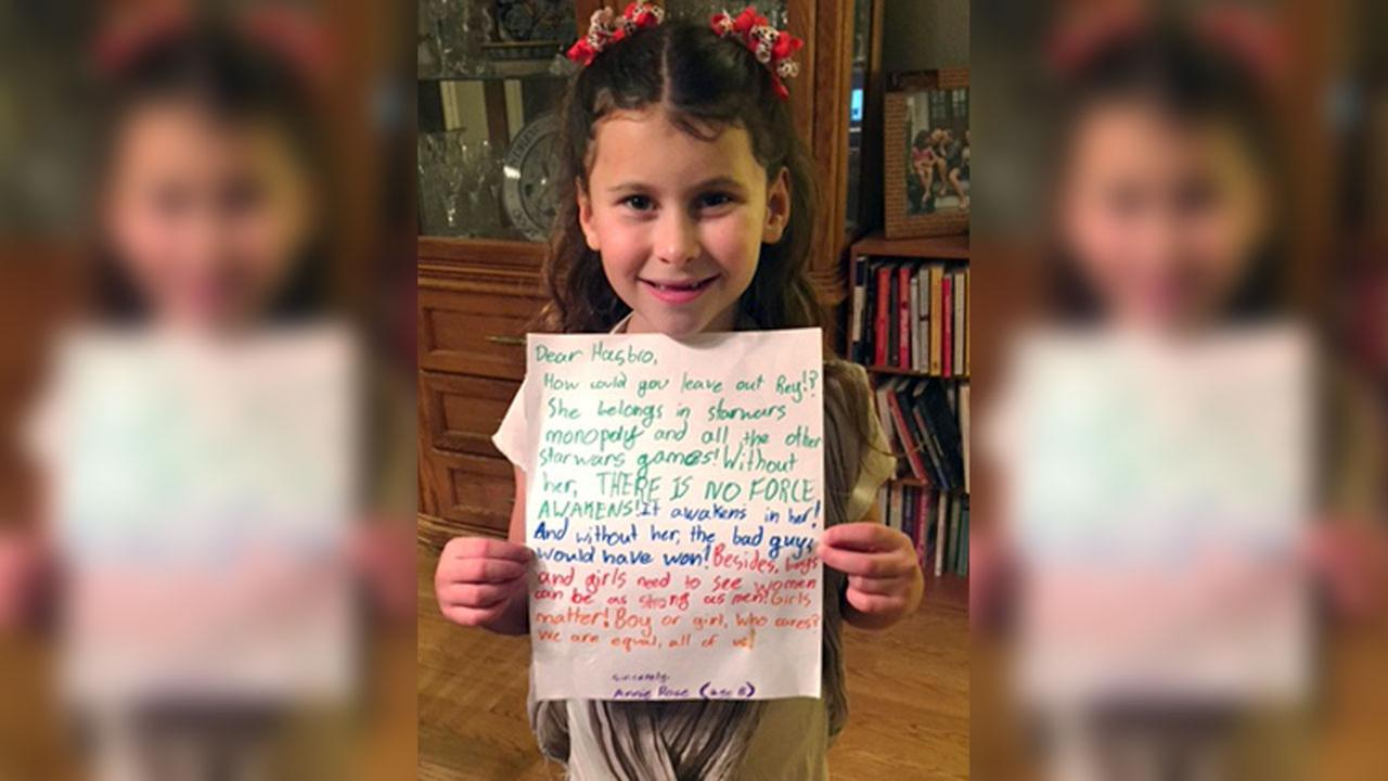 Annie Rose holds a letter in Evanston, Ill. that she wrote to Hasbro asking why the female character Rey was omitted from a Monopoly set based on Star Wars: The Force Awakens.