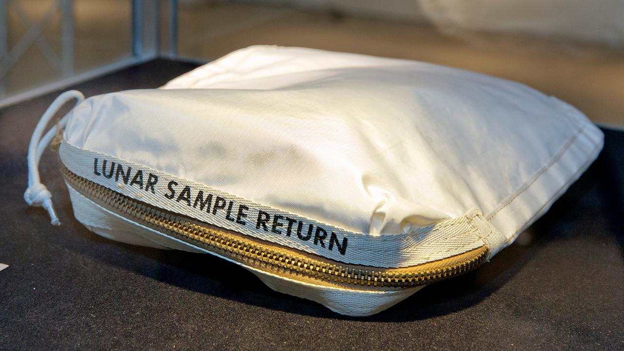 The Apollo 11 Contingency Lunar Sample Return Bag used by astronaut Neil Armstrong, to be offered at auction, is displayed at Sothebys. (AP Photo/Richard Drew)