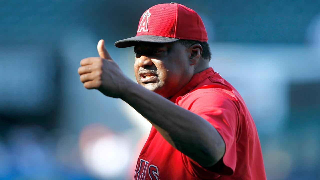Angels hitting coach Don Baylor gives a fan the thumbs up during warmups before a baseball game against the Texas Rangers in Anaheim in 2015. (AP Photo/Alex Gallardo)