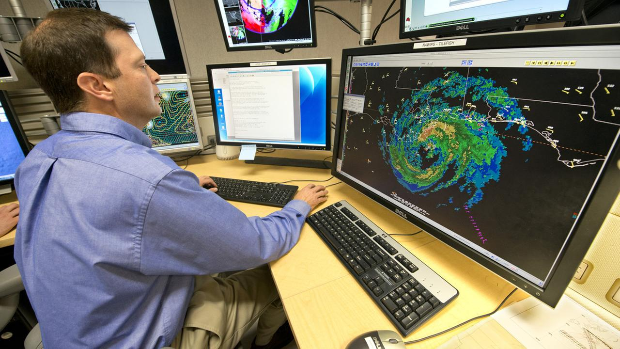 At the National Hurricane Center in Miami, hurricane specialist Dan Brown watches a radar image of Hurricane Isaac Tuesday, Aug. 28. 2012.