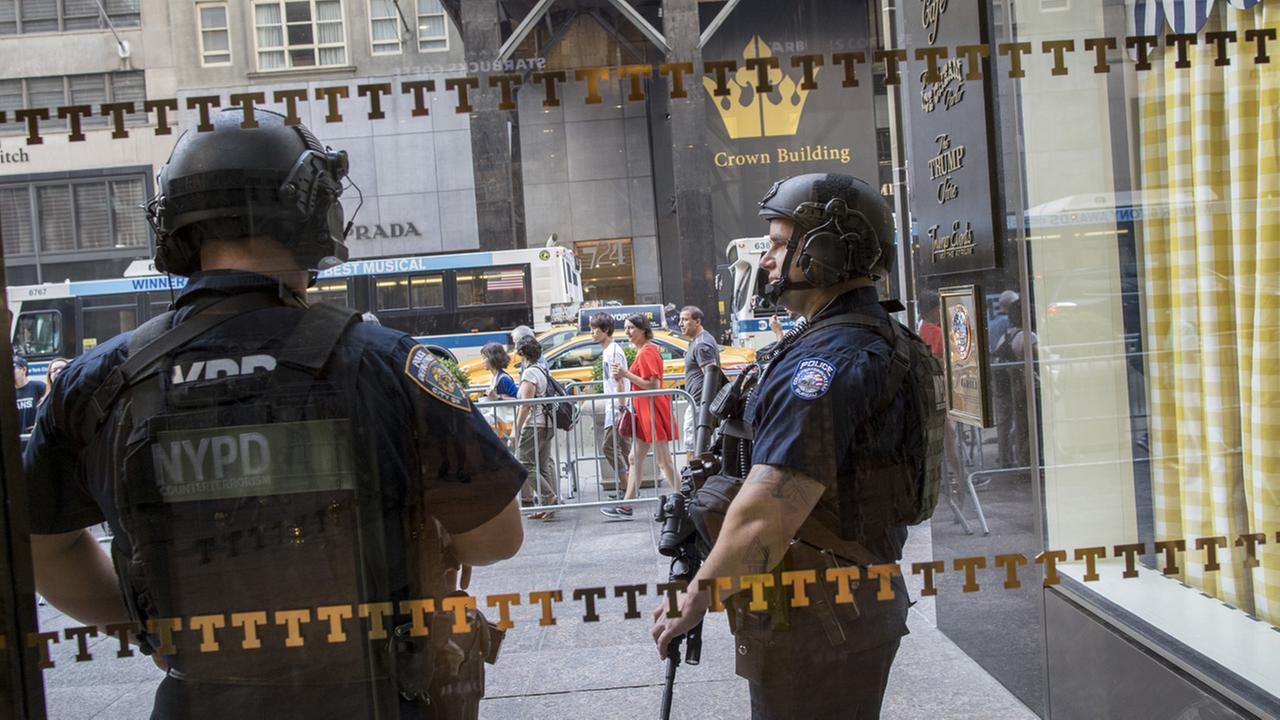 Heavily armed police officers with the Counter Terrorism unit stand guard outside Trump Tower in New York on Aug. 10, 2017.