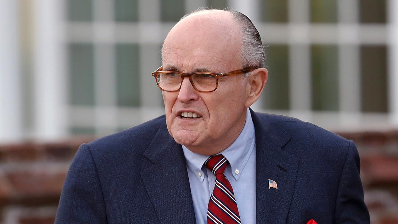 Former New York Mayor Rudy Giuliani arrives at the Trump National Golf Club Bedminster clubhouse, Sunday, Nov. 20, 2016. (AP Photo/Carolyn Kaster)