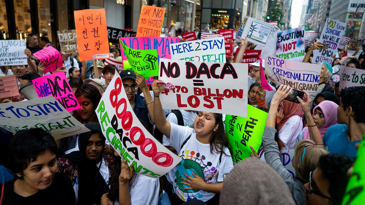 Activists supporting Deferred Action for Childhood Arrivals (DACA), and other immigration issues gather near Trump Tower  (AP Photo/Craig Ruttle)