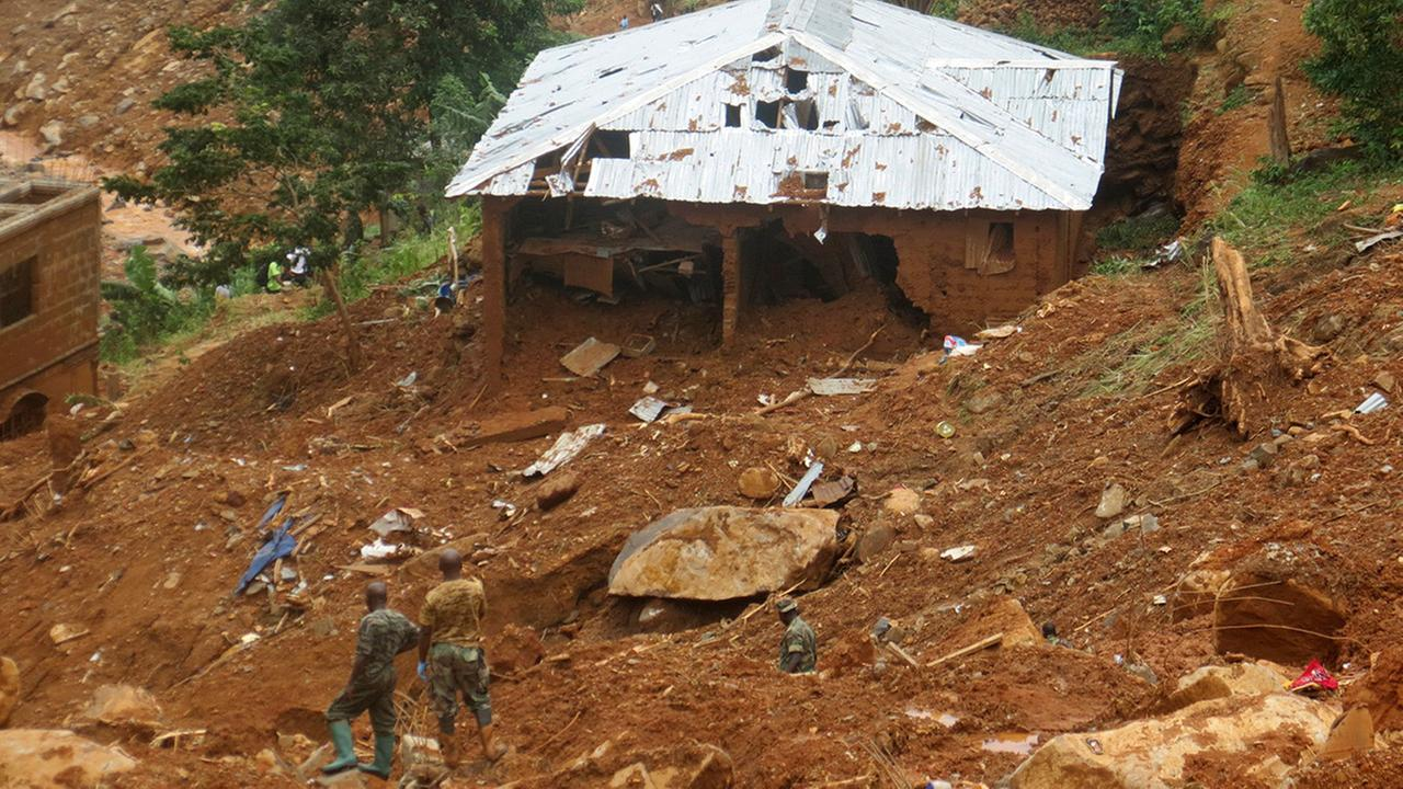 Security forces search for bodies from the scene of heavy flooding and mudslides in Regent, just outside of Sierra Leones capital Freetown, Tuesday, Aug. 15 , 2017.