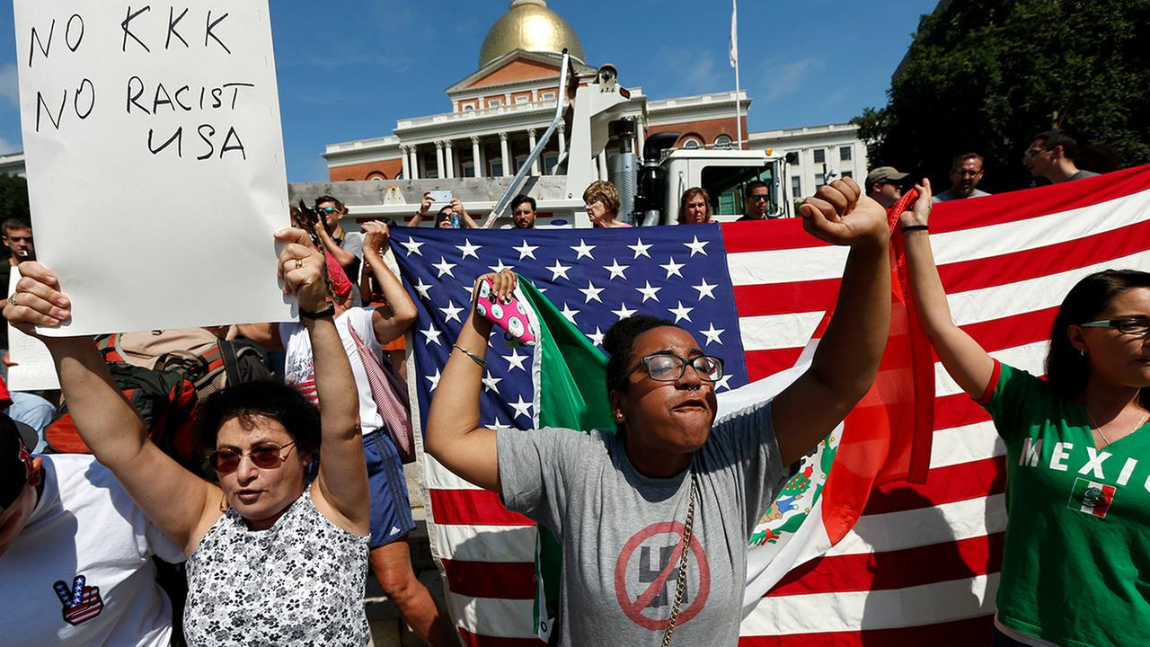 Counterprotesters hold signs and chant at the Statehouse before a planned Free Speech rally by conservative organizers begins on the adjacent Boston Common
