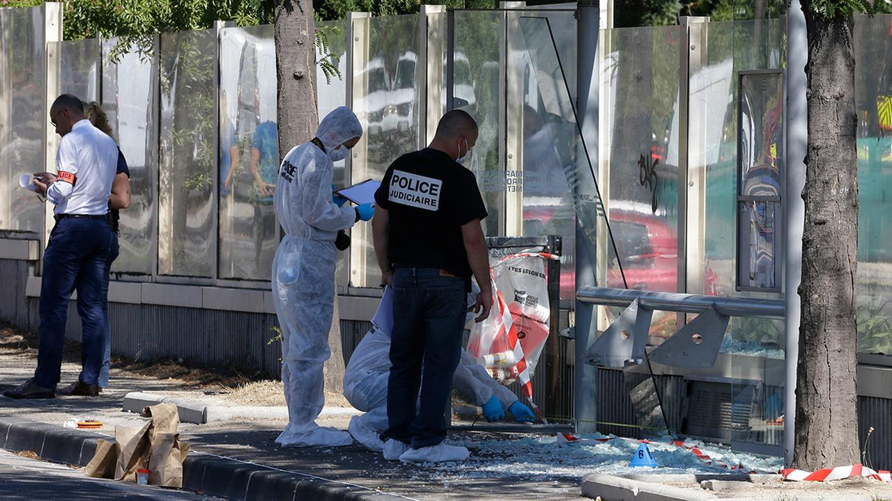 Police officers inspect a bus stop in La Valentine district after a van rammed into two bus stops in the French port city of Marseille, southern France, Monday Aug.21, 2017.